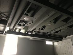 Exposed & painted basement ceiling. Spray painted.