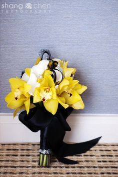 Don't really like orchids or callas, but i like the contrast of yellow, white and black for the girls - no feathers tho