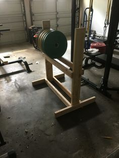 Diy plate storage. Plan to add a shelf on top for dumbells