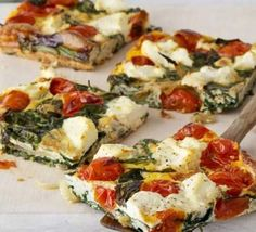 Ricotta, tomato & spinach frittata - a pretty and healthy easy meal for your family!  Cherry tomatoes, spinach, basil, ricotta and eggs make for a savory treat.