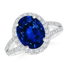 Make a statement with this Split Shank Vintage Tanzanite Ring with Diamond Halo - April 21 2019 at The Sapphires, Blue Sapphire Rings, Sapphire Jewelry, Diamonds And Gold, Round Diamonds, Halo Diamond, Diamond Stone, Beautiful Rings, Gemstone Rings