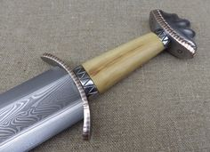 century Saxon sword, hilt work by Tod/todsstuff, blade work by Owen Bush. Fantasy Sword, Fantasy Weapons, Swords And Daggers, Knives And Swords, Albion Swords, Vikings, Heroic Age, Viking Sword, Sword Design