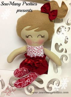 Celebrate Christmas with this special doll!!  This is a 15 inch Doll that is part of the Fancy Pants collection from Sew Many Pretties.  This cutie is handmade from 100% cotton fabrics and wool blend felt for her hair. Facial features are hand embroidered.  www.sewmanypretties.com Pattern used from www.dollsanddaydreams.com