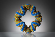 Blue-Bracelet by Suzanne Golden. Wowza colour and love the twisty-twiny way it wraps around itself. Almost alive!