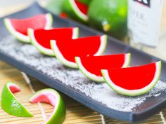 Watermelon gelatin that is set and served inside lime peels gives these shots the festive appearance of miniature watermelons. Using a juicer, juice the limes. Let the juice drop through a sieve into a bowl so that you can catch the seeds...