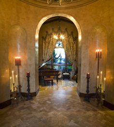 Candles light elegant foyer...lovely curtain with medallions