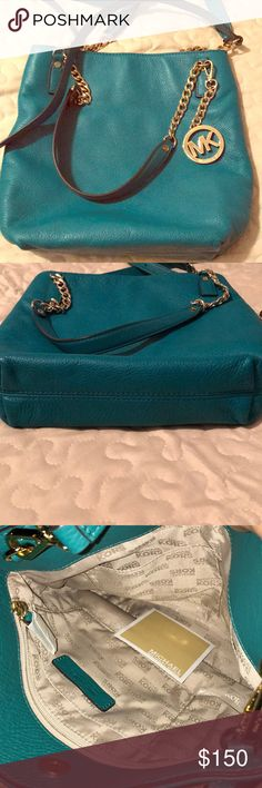 Michael Kors purse Teal color with a long shoulder strap you can use as a crossbody purse. Used once in mint condition.  You can see picture of inside still has paper wrap on zipper Michael Kors Bags Shoulder Bags