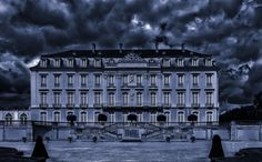 #architecture #baroque #building #castle #city #clouds #dark #downtown #dramatic #evening #facade #gloomy #historic #historical #home #house #landmark #mansion #museum #night #outdoors #road #storm #street #symmetry #trav