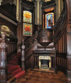 A lovely interior staircase with a fireplace and stained glass windows, that exemply the decor of America's Gilded Age. Located in the, Bishop's Place/Gresham Castle. Built by architect Nicholas J. Clayton, c.1887 to c.1893. Originally owned by Walter Gresham, an American lawyer and politician. - Location: 1402 Broadway in Galveston, Texas. ~ {cwlyons}