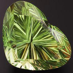 Fancy cut Tsavorite garnet heart. No, not all garnets are red. :)