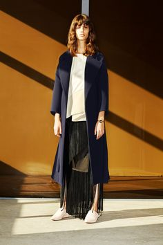 Long topper, longer fringe skirt. Can't look away. This manages to feel freshest for fall so far.  10 Crosby Derek Lam | Pre-Fall 2014 Collection | Style.com
