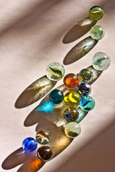 I like the idea of creating interesting shadows using marbles. Different coloured marbles create amazing looking shadows like in this photograph. I like the different shadows in this piece