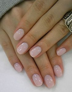 Light pink nail polish.