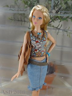 https://flic.kr/p/Gc9wK6 | Floral Flair Tall Barbie | In my opinion, the black and pink floral dress she originally came in is pretty, but it's a bit too boxy and does nothing to show off her shape. Alternatively, I think she carries off this fitted Southwest/Boho combination really well.  Top & Skirt: Barbie My Scene Fringe Handbag: Barbie Fashionistas Necklace & Bracelet: Made By Me Cowboy Boots: Purchased on eBay. Origin unknown.