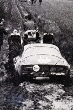 "1972 ""Rallye Infernal"" François Cevert pulling his Alpine A110 out of the mud using a tractor."