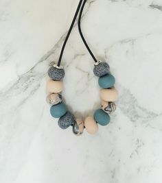 Polymer clay necklace, leather cord necklace, scandi , beaded necklace by Seekinghazel on Etsy https://www.etsy.com/sg-en/listing/472768872/polymer-clay-necklace-leather-cord
