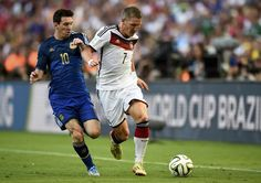 Argentina's Lionel Messi (L) and Germany's Bastian Schweinsteiger run for the ball during their 2014 World Cup final at the Maracana stadium in Rio de Janeiro July 13, 2014.