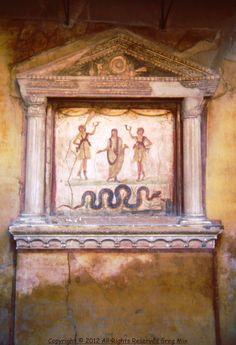 The altar in the Villa of the Vettii, Pompeii.