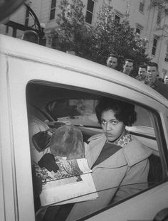 Charlayne Hunter (1961) leaving the University of Georgia campus after registering as a student. She holds a place in Georgia civil rights history as one of the first two African American students (the other student was Hamilton Holmes) admitted to the University of Georgia. Also known for her career as an award-winning journalist, Hunter-Gault is respected for her work on television and in print.