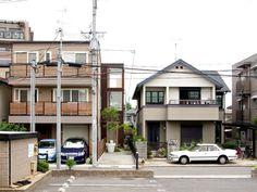 yaneura design sets hagoromo house amid neighboring homes in osaka, japan