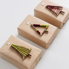 Make these tree gift toppers using festive embroidery floss and twigs.