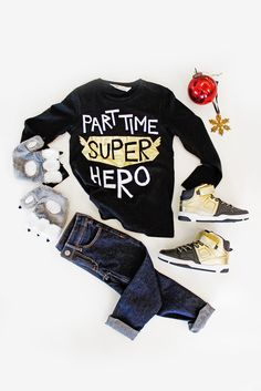 It's a bird, it's a plane, it's your favorite little super hero! Your fearless guy will feel invincible in this printed sweatshirt, plush bear paw mittens and gold high tops. Find the perfect gifts for your little one at H&M.