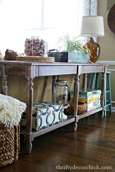 I love how this behind-the-couch table, or sofa table, looks, but I especially love that blue and white box!! I want something like this for our nightstands!