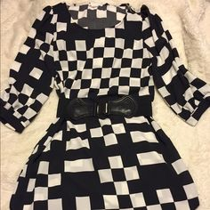 Color block dress Black and white color block dress. Belt is not included. In excellent condition Dresses Mini