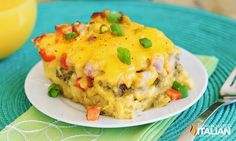 Overnight Cheesy Breakfast Casserole- We've got a brilliant use for leftover biscuits! This make ahead breakfast casserole is simply to die for.