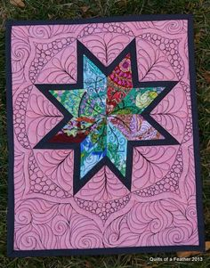 Quilts of a Feather and swirls around Mini Lone Star
