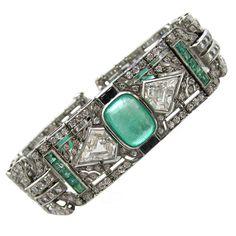 Art Deco Diamond & Emerald Bracelet | From a unique collection of vintage link bracelets at http://www.1stdibs.com/jewelry/bracelets/link-bracelets/