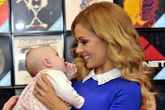 Katherine Jenkins enjoys a cwtch with a miracle baby as crowds gather for Cardiff signing