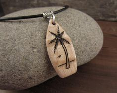Handmade Wood Surfboard Necklace With Hand Engraved Palm Tree Pendant by Victor Coolidge @ SepiaTree Wood Necklace, Engraved Necklace, Leather Necklace, Wood Burning Crafts, Wood Burning Patterns, Wooden Christmas Ornaments, Prim Christmas, Ocean Jewelry, Tree Pendant