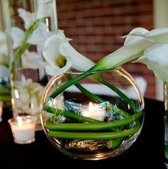 Calla lily centerpiece with candle #weddings #calla #centerpiece