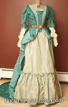 Here be a stunning turquoise silk gown with stomacher, seafoam green underskirt, white lace top and belt. The dress has a long Mantua train. Perfect fer Buccaneer Era and early Golden Age Pirate event
