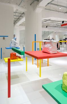 Visual merchandising master. Hanging sticks create illusions of chairs at Issey Miyake boutique in Tokyo