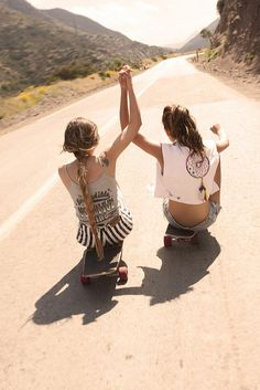 Friends of a feather, longboard together. That dream-catcher top and those pinstripe shorts are cute.