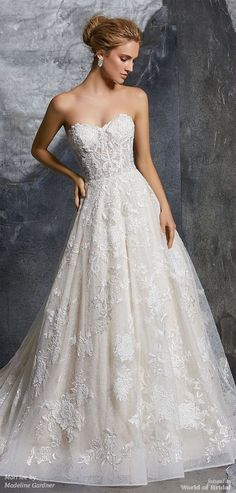 Mori lee by Madeline Gardner Spring 2018 Chic Chantilly Lace Ball Gown Featuring Layers of Lace, with Beaded and Embroidered Appliqués. The Exposed Boned Sweetheart Bodice is Trimmed in Covered Buttons. Matching Satin Bodice Lining Included.