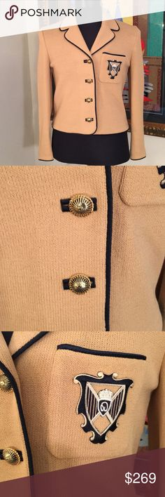❤️ST. JOHN COLLECTION JACKET /BLAZER 💯AUTHENTIC ❤️ST. JOHN COLLECTION JACKET /BLAZER 💯AUTHENTIC ! STUNNING AND STYLISH ALWAYS ON TREND! TRUE SUPER HIGH END LUXURY! THE COLORS ARE TAN WITH DARK NAVY BKUE PIPING. BEAUTIFUL GOLD ORNATE LOGO BUTTONS. THE SIZE IS 4. THE CHEST MEASUREMENT IS 19 IN HES ACROSS AND 38 INCHES AROUND! THE LENGTH IS 22 INCHES St. John Jackets & Coats