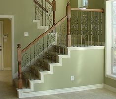 This staircase design was created using Twist series balusters. The single twist baluster (16.1.1), the double twist baluster (16.1.2), and the spiraled scroll baluster (16.1.25) are paired to create a uniquely designed staircase. These components are available in Satin Black (shown), Silver Vein, Copper Vein, Oil Rubbed Bronze, and Oil Rubbed Copper and Antique Nickel. We offer parts, install services, and custom components throughout Texas. Click the image for more information.