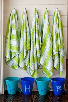 Creating a little nook like the one shown here will make it easier to hang beach towels when you get home and will ensure they're dry the next time they're needed. Keep buckets or baskets below to contain sandals and sunblock.