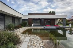 The One - modern garden pond house 5 Modern Residence in Hungary Oriented Towards a Garden Pond