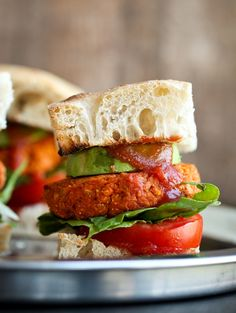 The most AMAZING Smoky barbecue sweet potato chickpea burgers that are vegan, gluten-free and oil-free. These impress every meat-eater! Easy, quick and delicious burgers with few basic ingredients.