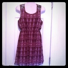 Cute Forever 21 magenta plaid dress Adorable plaid dress with black lace on back. Very versatile! Wear in summer with bare legs and in winter with tights, boots and a black leather jacket! I will throw in a pair of tights from H & M (worn once) that matches perfectly! Forever 21 Dresses
