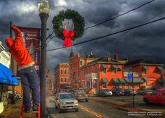 Brief spray of sunlight brightens Uptown as city workers install #UptownWesterville #wvloh #westerville #ohiogram #midwest #midwestlove #everydayohio #ohiopix #ohio #everydayusa  Christmas wreaths and banners.
