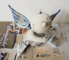 seated angel by KunstA on Etsy