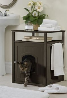 Conceal your cat's litter box in style with this Espresso Cat Washroom. This color is designed to match trendy dark wood furniture and accessories, and is suitable for use in almost every room of the