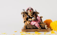 Hindu god ganesha. ganesha idol. a colorful statue of ganesha idol. space for text or headline.   Premium Photo Ganesh Chaturthi Photos, Happy Ganesh Chaturthi, Shri Ganesh Images, Ganesha Pictures, Festival Background, Red Background, Diwali Lights, Ganesh Lord, Indian Boy