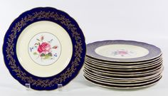 """Lot 410: Royal Swansea """"Swansea Rose"""" Plates; Thirteen plates with hand painted roses; artist signed"""