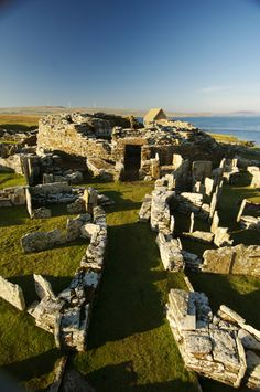 The Broch of Gurness (also known as Aikerness Broch) on Orkney sits beside Eynhallow Sound with views across to the island of Rousay.